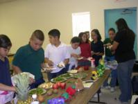 Image of students review food choices